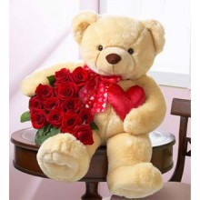 A Cute Teddy bear With Roses